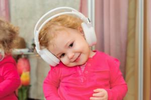 Little girl dancing in headphones